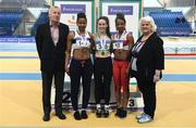 19 February 2017; Medallists in the Women's 60m Final, silver medallist Lynda Ngankam, Donore Harriers AC, Co Dublin, gold medallist Saragh Buggy, St Abban's AC, Co Laois, and bronze medallist Solange Diogo, Galway CIty Harriers AC, Co Galway, with, from left, Nick Davis, Honorary Life President, Athletics Ireland and Georgina Drumm, President of Athletics Ireland, during the Irish Life Health National Senior Indoor Championships at the Sport Ireland National Indoor Arena in Abbotstown, Dublin. Photo by Brendan Moran/Sportsfile