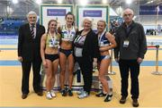 19 February 2017; Medallists in the Women's 60m, silver medallist Joan Healy, Bandon AC, Co Cork, gold medallist Ciara Neville, Emerald AC, Limerick, and bronze medallist Molly Scott, St Laurence O'Toole's AC, Co Carlow, with, from left, Ronnie Long, Past President, Athletics Ireland,  Georgina Drumm, President of Athletics Ireland, and Liam Hennessy, Past President, Athletics Ireland, during the Irish Life Health National Senior Indoor Championships at the Sport Ireland National Indoor Arena in Abbotstown, Dublin. Photo by Brendan Moran/Sportsfile