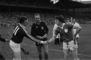 7 September 1980; Galway captain Joe Connolly shakes hands with Limerick captain Seán Foley ahead of the All Ireland Hurling Final, Galway v Limerick, Croke Park, Dublin. Photo by Ray McManus/Sportsfile