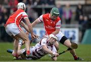 25 February 2017; Brian Cassidy of Slaughtneil in action against Darragh Connell, left, and Simon Timlin, right, of Cuala during the AIB GAA Hurling All-Ireland Senior Club Championship Semi-Final match between Cuala and Slaughtneil at the Athletic Grounds in Armagh. Photo by Eóin Noonan/Sportsfile