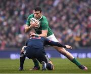 25 February 2017; Robbie Henshaw of Ireland is tackled by Camille Lopez of France during the RBS Six Nations Rugby Championship game between Ireland and France at the Aviva Stadium in Lansdowne Road, Dublin. Photo by Brendan Moran/Sportsfile