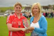 1 August 2011; Cork's Emma Farmer is presented with the player of the match trophy by Helen O'Rourke, CEO of the Ladies Gaelic Football Association. All Ireland Minor A Championship Final, Dublin v Cork, Birr, Co. Offaly. Picture credit: Paul Mohan / SPORTSFILE