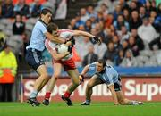 6 August 2011; Enda McGinley, Tyrone, in action against Rory O'Carroll and Denis Bastick, right, Dublin. GAA Football All-Ireland Senior Championship Quarter-Final, Dublin v Tyrone, Croke Park, Dublin. Picture credit: Oliver McVeigh / SPORTSFILE