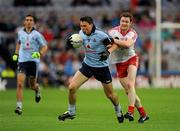 6 August 2011; Éamon Fennell, Dublin, in action against Enda McGinley, Tyrone. GAA Football All-Ireland Senior Championship Quarter-Final, Dublin v Tyrone, Croke Park, Dublin. Picture credit: Ray McManus / SPORTSFILE