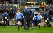 4 March 2017; Allianz mascot Aaron Miller, from St Brigid's NS, Killester, Dublin, runs out with Dublin captain Stephen Cluxton ahead of the Allianz Football League Division 1 Round 4 game between Dublin and Mayo at Croke Park in Dublin. Photo by Brendan Moran/Sportsfile