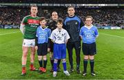 4 March 2017; Allianz mascots, from left, Cian Lumley, from St Brigid's NS, Killester, Dublin, John Chew St Pius X NS, Templeogue, Dublin, and Aaron Miller, St Brigid's NS, Killester, Dublin, with team captains Cillian O'Connor of Mayo and Stephen Cluxton of Dublin and referee David Coldrick, ahead of the Allianz Football League Division 1 Round 4 game between Dublin and Mayo at Croke Park in Dublin. Photo by Brendan Moran/Sportsfile