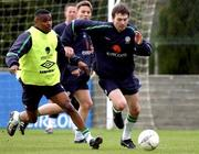 25 March 2002; Republic of Ireland's Gary Breen in action against team-mate Clinton Morrison, left, during squad training. John Hyland Park, Baldonnel, Co. Dublin. Soccer. Picture credit; David Maher / SPORTSFILE *EDI*