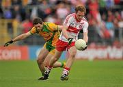 17 July 2011; Sean Leo McGoldrick, Derry, in action against Ryan Bradley, Donegal. Ulster GAA Football Senior Championship Final, Derry v Donegal, St Tiernach's Park, Clones, Co. Monaghan. Picture credit: Brendan Moran / SPORTSFILE