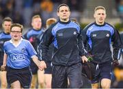4 March 2017; Allianz mascot Aaron Miller, from St Brigid's NS, Killester, Dublin, runs out with Dublin captain Stephen Cluxton ahead of the Allianz Football League Division 1 Round 4 match between Dublin and Mayo at Croke Park in Dublin. Photo by David Fitzgerald/Sportsfile