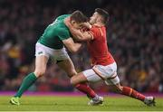 10 March 2017; Garry Ringrose of Ireland is tackled by Rhys Webb of Wales during the RBS Six Nations Rugby Championship match between Wales and Ireland at the Principality Stadium in Cardiff, Wales. Photo by Brendan Moran/Sportsfile