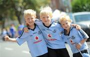14 August 2011; Dublin supporters and brothers, from left, Adam, age 7, Ian, age 9, and Colin McAweeney, age 4, from Killester, on their way to the GAA Hurling All-Ireland Senior Championship Semi-Final, Croke Park, Dublin. Picture credit: Brian Lawless / SPORTSFILE