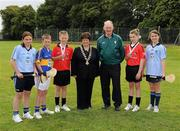 14 August 2011; Vice President of the I.N.T.O. Anne Fay with, from left, Aoife Coughlin, Crecora N.S., Patrickswell, Co. Limerick, Cormac Doyle, C.B.S., Doon, Co. Limerick, Mark Coleman, Doon, Co. Limerick, Rev. Bro. Dormer, President of Cumann na mBunscoil, Limerick, Caileigh O'Reilly, St. Joseph's N.S., Ballybrown, Co. Limerick, and Danielle Grehan, Our Lady's Abbey N.S., Adare, Co. Limerick. Go Games Exhibition - Sunday 14th August 2011, Clonliffe College,  Dublin. Picture credit: Ray McManus / SPORTSFILE