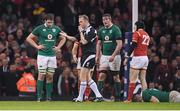 10 March 2017; Ireland players, from left, Iain Henderson, Donnacha Ryan and Jamie Heaslip as referee Wayne Barnes blows the final whistle of the RBS Six Nations Rugby Championship match between Wales and Ireland at the Principality Stadium in Cardiff, Wales. Photo by Brendan Moran/Sportsfile