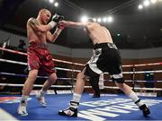 10 March 2017; Gary Corcoran, right, in action against James Gorman during their welterweight bout in the Waterfront Hall in Belfast. Photo by Ramsey Cardy/Sportsfile