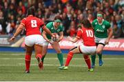 11 March 2017; Lindsay Peat of Ireland is tackled by Robyn Wilkins(10)and Shona Powell-Hughes of Wales during the RBS Women's Six Nations Rugby Championship match between Wales and Ireland at BT Sport Arms Park, Cardiff, Wales. Photo by Darren Griffiths/Sportsfile