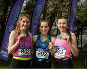 11 March 2017; Medalists in the Senior Girls race, from left, bronze medallist Stephanie Cotter, of Coachford college, Cork, gold medalist Sophie Murphy of Mount Anville, Dublin, and Silver medalist Jodie McCann Institute of Education of Naas Co. Kildare during the Irish Life Health All Ireland Schools Cross Country at Mallusk Playing Fields in Newtownabbey, Co. Antrim. Photo by Oliver McVeigh/Sportsfile