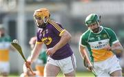 12 March 2017; David Redmond of Wexford in action against Derek Morkan of Offaly during the Allianz Hurling League Division 1B Round 4 match between Offaly and Wexford at O'Connor Park in Tullamore, Co. Offaly. Photo by David Maher/Sportsfile