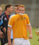 20 August 2011; A disappointed Conor Gillan, Antrim, after the final whistle. Bord Gais Energy GAA Hurling Under 21 All-Ireland Championship Semi-Final, Antrim v Dublin, Pairc Esler, Newry, Co. Down. Picture credit: Oliver McVeigh / SPORTSFILE