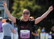 20 August 2011; Gillian Harris, Dublin, celebrates as she crosses the finish line at the National Lottery Frank Duffy 10 Mile race, Phoenix Park, Dublin. Picture credit: Conor O Beolain / SPORTSFILE