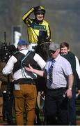 15 March 2017; David Bass celebrates as he enters the parade ring after winning the Neptune Investment Management Novices' Hurdle on Willoughby Court during the Cheltenham Racing Festival at Prestbury Park in Cheltenham, England. Photo by Cody Glenn/Sportsfile