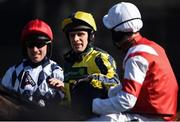 15 March 2017; David Bass, centre, is congratulated by fellow jockeys Jeremiah McGrath, left, and Kielan Woods, right, after winning the Neptune Investment Management Novices' Hurdle on Willoughby Court during the Cheltenham Racing Festival at Prestbury Park in Cheltenham, England. Photo by Seb Daly/Sportsfile