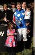15 March 2017; Jockey Noel Fehily with his son Michael, age 2, and daughter Niamh, age 4, after winning the Betway Queen Mother Champion Steeple Chase on Special Tiara during the Cheltenham Racing Festival at Prestbury Park in Cheltenham, England. Photo by Cody Glenn/Sportsfile