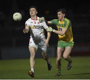 15 March 2017; Ben O'Donnell of Tyrone in action against Michael Langan of Donegal during the EirGrid Ulster GAA Football U21 Championship Quarter-Final match between Tyrone and Donegal at Healy Park in Omagh, Co Tyrone. Photo by Philip Fitzpatrick/Sportsfile