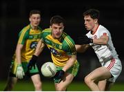 15 March 2017; Tony McCleneghan of Donegal in action against David Mulgrew of Tyrone during the EirGrid Ulster GAA Football U21 Championship Quarter-Final match between Tyrone and Donegal at Healy Park in Omagh, Co Tyrone. Photo by Philip Fitzpatrick/Sportsfile
