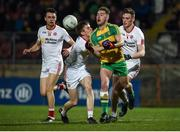 15 March 2017; Tony McCleneghan of Donegal in action against Ryan Loughan of Tyrone during the EirGrid Ulster GAA Football U21 Championship Quarter-Final match between Tyrone and Donegal at Healy Park in Omagh, Co Tyrone. Photo by Philip Fitzpatrick/Sportsfile