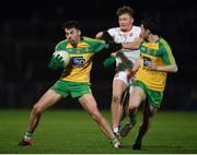15 March 2017; Michael Carroll, (L), and Cian Mulligan of Donegal in action against Feargal Meenagh of Tyrone during the EirGrid Ulster GAA Football U21 Championship Quarter-Final match between Tyrone and Donegal at Healy Park in Omagh, Co Tyrone. Photo by Philip Fitzpatrick/Sportsfile