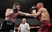 10 March 2017; Gary Corcoran, left, in action against James Gorman during their welterweight bout in the Waterfront Hall in Belfast. Photo by Ramsey Cardy/Sportsfile