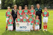 21 August 2011; INTO President Noreen Flynn with the Mayo boys team, back row, left to right, Aodhán Ó Bogaigh, Scoil Mobhi, Co. Dublin, Darren O'Dwyer, Scoil Teampall Toinne, Ballyporeen, Co. Tipperary, Patrick Smyth, Scoil Eoin Baiste, Clontarf, Co. Dublin, Conor Diskin, Barnacarroll N.S., Claremorris, Co. Mayo, front row, left to right, Cathal O'Mahony, Mitchelstown C.B.S., Co. Cork, Brandon Murphy, Shanagolden N.S., Shanagolden, Co. Limerick, Patrick Warren, Raheen N.S., Headford, Co. Kerry, Liam Harrington, Scoil An Spioraid Naoimh, Roxborough, Co. Limerick, Cathal Darcy, Ennis N.S., Ennis, Co. Clare. Go Games Exhibition - Sunday 21st August 2011, Clonliffe College, Dublin. Picture credit: Ray McManus / SPORTSFILE