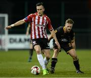 13 March 2017; Aaron McEneff of Derry City in action against Conor Clifford of Dundalk during the SSE Airtricity League Premier Division match between Derry City and Dundalk at Maginn Park in Buncrana, Donegal. Photo by Oliver McVeigh/Sportsfile