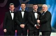 3 November 2017; Cork hurler Patrick Horgan is presented with his PwC All Star award from Uachtarán Chumann Lúthchleas Gael Aogán Ó Fearghail, in the company of Feargal O'Rourke, left, Managing Partner, PwC, and David Collins, GPA President during the PwC All Stars 2017 at the Convention Centre in Dublin. Photo by Brendan Moran/Sportsfile