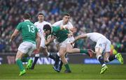 18 March 2017; Robbie Henshaw of Ireland is tackled by George Ford and Owen Farrell, right, of England  during the RBS Six Nations Rugby Championship match between Ireland and England at the Aviva Stadium in Lansdowne Road, Dublin. Photo by Brendan Moran/Sportsfile