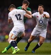 18 March 2017; Garry Ringrose of Ireland is tackled by Owen Farrell, left, and Ben Youngs of England during the RBS Six Nations Rugby Championship match between Ireland and England at the Aviva Stadium in Lansdowne Road, Dublin. Photo by Stephen McCarthy/Sportsfile