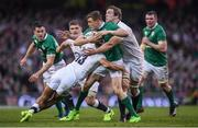 18 March 2017; Garry Ringrose of Ireland is tackled by Jonathan Joseph, 13, and Joe Launchbury of England during the RBS Six Nations Rugby Championship match between Ireland and England at the Aviva Stadium in Lansdowne Road, Dublin. Photo by Stephen McCarthy/Sportsfile