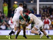 18 March 2017; Robbie Henshaw of Ireland is tackled by Owen Farrell, left, and James Haskell of England during the RBS Six Nations Rugby Championship match between Ireland and England at the Aviva Stadium in Lansdowne Road, Dublin. Photo by Sam Barnes/Sportsfile