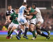 18 March 2017; Cian Healy of Ireland is tackled by George Ford, left, and Maro Itoje of England during the RBS Six Nations Rugby Championship match between Ireland and England at the Aviva Stadium in Lansdowne Road, Dublin. Photo by Stephen McCarthy/Sportsfile