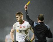 18 March 2017; Conor Meyler of Tyrone receives a yellow card from Referee David Coldrick during the Allianz Football League Division 1 Round 5 match between Donegal and Tyrone at MacCumhaill Park in Ballybofey, Co Donegal. Photo by Oliver McVeigh/Sportsfile