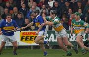 30 March 2002; Eoin Kelly, Tipperary, in action against Hubert Rigney, Offaly. Allianz National Hurling League, Offaly v Tipperary, St Brendan's Park, Birr, Co. Offaly. Picture credit; Brendan Moran / SPORTSFILE *EDI*
