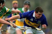 30 March 2002; John Carroll, Tipperary, in action against Hubert Rigney, Offaly. Allianz National Hurling League, Offaly v Tipperary, St Brendan's Park, Birr, Co. Offaly. Picture credit; Brendan Moran / SPORTSFILE