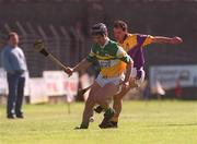 7 April 2002; Hubert Rigney, Offaly's, in action against Wexford's Adrian Fenlon. Offaly v Wexford, National Hurling League, Birr, Co. Offaly. Picture credit; Aoife Rice / SPORTSFILE