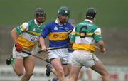 30 March 2002; David Kennedy, Tipperary, in action against Hubert Rigney (6) and Gary Hannify, Offaly. Allianz National Hurling League, Offaly v Tipperary, St Brendan's Park, Birr, Co. Offaly. Picture credit; Brendan Moran / SPORTSFILE *EDI*