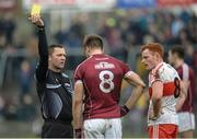 19 March 2017; Paul Conroy of Galway is shown a yellow card by referee Rory Hickey during the Allianz Football League Division 2 Round 5 match between Galway and Derry at St Jarlath's Park in Tuam, Co Galway. Photo by Sam Barnes/Sportsfile