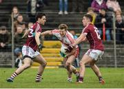 19 March 2017; Enda Lynn of Derry in action against Shane Walsh and Eamonn Brannigan of Galway during the Allianz Football League Division 2 Round 5 match between Galway and Derry at St. Jarlath's Park in Tuam, Co Galway. Photo by Sam Barnes/Sportsfile
