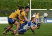 19 March 2017; Kieran Hughes of Monaghan in action against Donie Smith and Tadgh O'Rourke of Roscommon during the Allianz Football League Division 1 Round 5 match between Monaghan and Roscommon at Pairc Grattan in Inniskeen, Co. Monaghan. Photo by Philip Fitzpatrick/Sportsfile