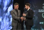 19 March 2017; Robbie Brady is presented with the Young International Player of the Year by Republic of Ireland Assistant Manager Roy Keane during the Three FAI International Soccer Awards at RTE Studios in Donnybrook, Dublin. Photo by Brendan Moran/Sportsfile