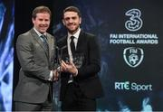 19 March 2017; Robbie Brady is presented with the International Goal of the Year by Gavin McAllister, PR & Sponsorship Manager at Three Ireland, during the Three FAI International Soccer Awards at RTE Studios in Donnybrook, Dublin. Photo by Brendan Moran/Sportsfile