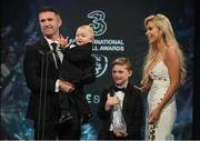 19 March 2017; Former Republic of Ireland captain and record goalscorer Robbie Keane, who was inducted into the Hall of Fame, with wife Claudine and sons Hudson left, and Robert Jnr, during the Three FAI International Soccer Awards at RTE Studios in Donnybrook, Dublin. Photo by Brendan Moran/Sportsfile
